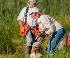 Ed Erickson working with an gun dog owner and her trained hunting dog